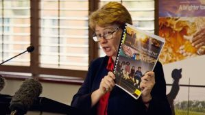 """Amnesty International Australia Director Claire Mallinson with the Qld Report, """"Heads Held High"""""""